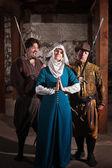 Swordsmen Teasing Nun — Stock Photo