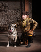 Serious Medieval Man with Dog — Stock Photo