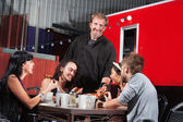 Canteen Owner with Happy Diners — Stock Photo