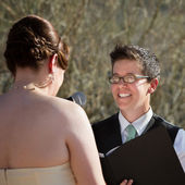 Lady Reading Vows to Bride — Stock Photo