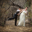 Newlyweds Playing in Forest — Stock Photo