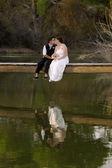 Kissing Female Couple at Lake — Stock Photo