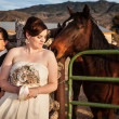 Lesbian Bride with Partner and Horse - Stock Photo