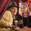 Fortune Teller and Skeptical Man - Stock Photo