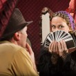 Stock Photo: Customer Chooses Tarot Card
