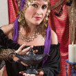 Fortune Teller Rubs the Lamp - Lizenzfreies Foto