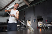 Glass Artist with Piece on Workbench — Stock Photo