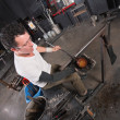 Artisan Handling Hot Glass - Stock Photo