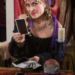 Stock Photo: Fortune Teller Dealing Tarot Cards