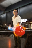Man Blasting Glass with Flames — Stock Photo