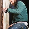 Stock Photo: Kneeling MSpray Painting