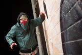 Scared Gangster with Spray Paint — Stock Photo