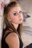 Serious Girl at Wall — Stock Photo