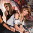 Smiling Teen Sitting with Friends — Stock Photo #29420419