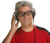 Squinting Man with Headphones — Stock Photo