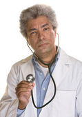 Doctor Using Stethoscope — Stock Photo