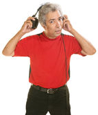 Man Removing Headphones — Stock Photo