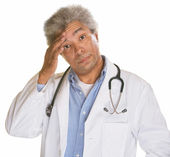 Doctor Scratching Forehead — Stock Photo
