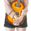 Coy Lady Holding Guitar — Stockfoto