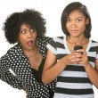 Foto Stock: Shocked Mother and Texting Teenager