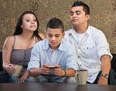 Parents Watching Teen Sending Messages — Stock Photo