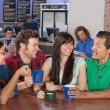 Stock Photo: Cheerful Friends Socializing