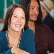 Smiling Woman with Man in Cafe — Lizenzfreies Foto