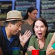 Stock Photo: Embarrassed Group in Cafe