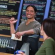 Cute Cafe Worker Pointing at Menu — Stock Photo
