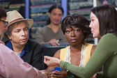 Perplexed Woman with Group in Cafe — Stock Photo