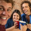 Stock Photo: Friends Toasting with Coffee Mugs