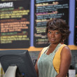 Woman at Cash Register — Stock Photo