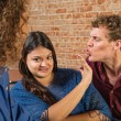 Man Kissing Annoyed Woman — Stock Photo