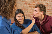 Man Kissing Annoyed Woman — Stock Photo
