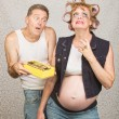 Stock Photo: Moody Pregant Lady and Man