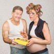 Smiling Man Feeding Pregnant Woman — Stockfoto
