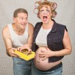 Stock Photo: Sorry Mwith Angry Expecting Woman