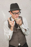 Smirking Man Sipping Martini — Stock Photo