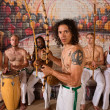 Latino Capoeira Performer with Group — Stock Photo