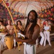Capoeira Man with Dreadlocks and Instruments — Stock Photo
