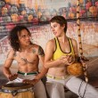 Capoeira Couple Playing Traditional Instruments — Stok fotoğraf
