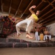 Stock Photo: Flexible CapoeirWoman