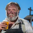 Stock Photo: Old West Drunkard Drinks