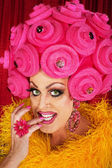 Grinning Drag Queen Biting Fingernails — Stock Photo