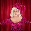 Foto Stock: Blond Drag Queen Singing