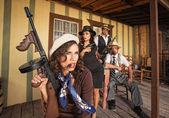 Tough Smoking Woman with Submachine Gun — Stock Photo