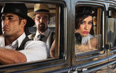 Pretty Woman in Car with Gangsters — Stock Photo