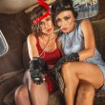 Smoking Flapper Women in Car — Stock Photo #39258375