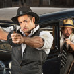 Постер, плакат: 1920s Era Gangsters with Guns and Car