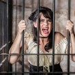 Stock Photo: Portrait of Screaming Female Prisoner
